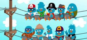 Diferents ocells de twitter penjats d'un cable de la llum